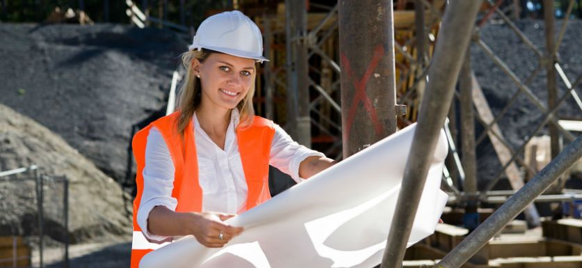 hiring a 1099 subcontractor agreement woman holding blueprints