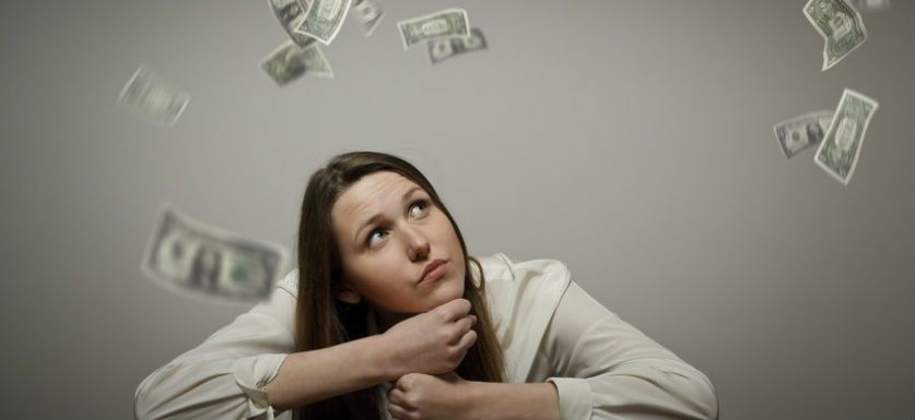 Picture of woman pondering fsa refund wanting to find out what you can do with forfeited FSA funds.