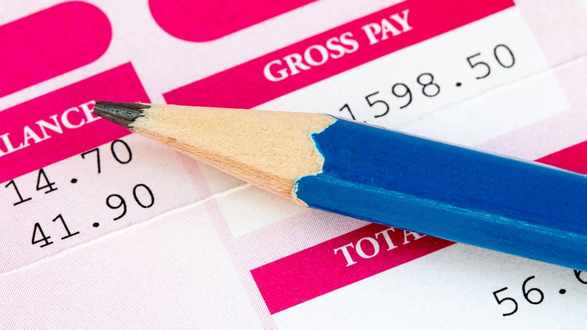 pencil on paper determining payroll tax withholding
