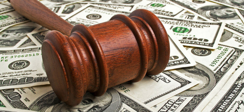 what is garnishment picture of gavel on layer of cash