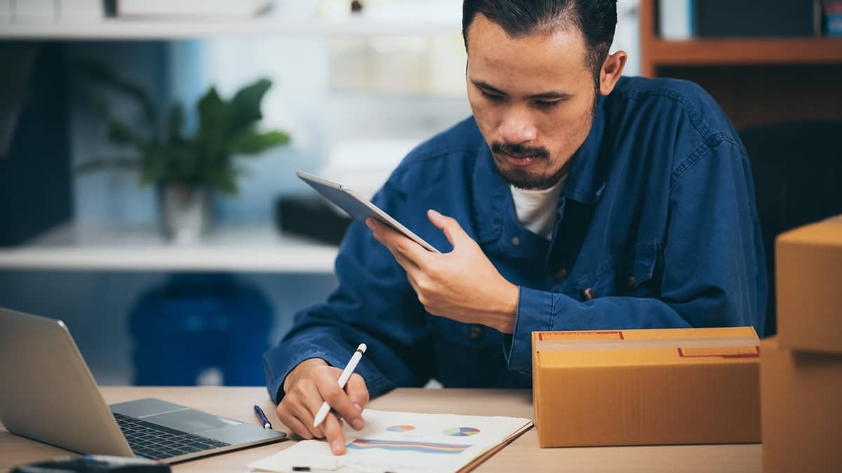 man working on accounting forms for his small business