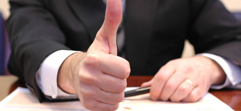 man giving thumbs up after making a compound journal entry