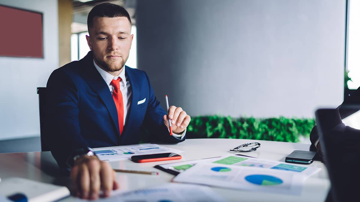 man learning about the 3 golden rules of accounting and looking at charts