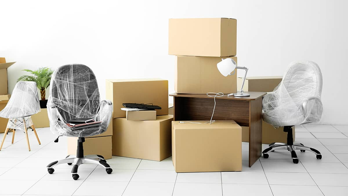 boxes and wrapped chairs during a business change of address