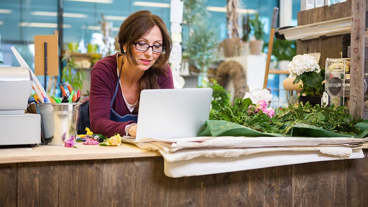 woman on computer in her small business