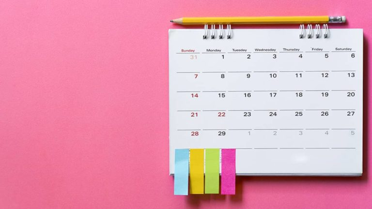 calendar with sticky notes to represent a waiting period